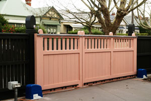 wooden gates with auto gate openers